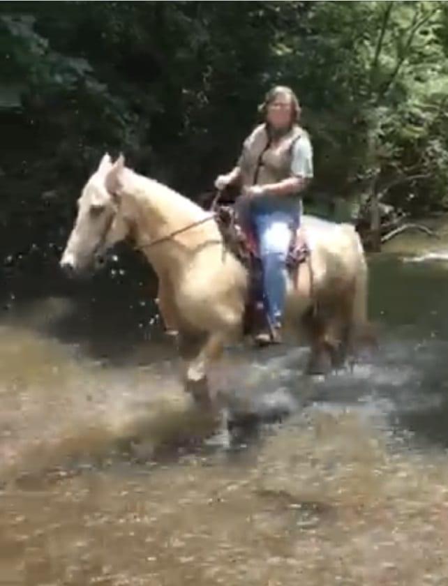 Becca walking in Creek